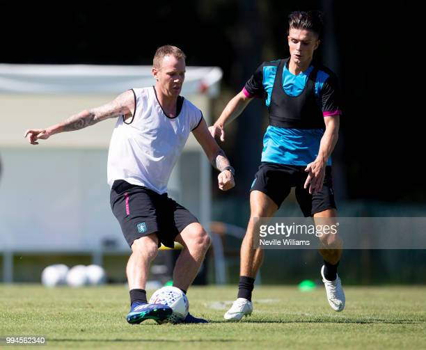 Glenn Whelan of Aston Villa in action with team mate Jack Grealish during an Aston Villa training session at the club's training camp on July 09 2018...
