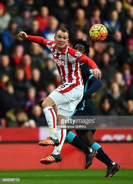 Glenn Whelan of Stoke City and Wilfred Bony of Manchester City compete for the ball during the Barclays Premier League match between Stoke City and...