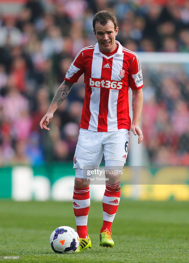 Glenn Whelan of Stoke City in action during the Barclays Premier League match between Stoke City and Hull City at Britannia Stadium on March 29, 2014 in Stoke on Trent, England.