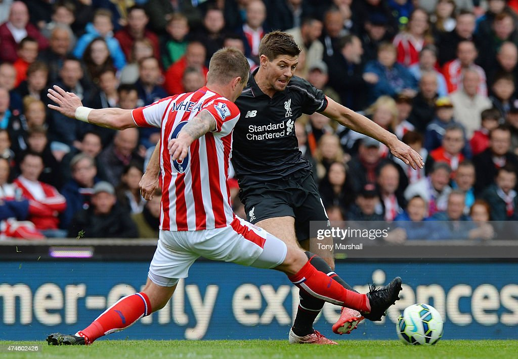 Glenn Whelan of Stoke City tackles Steven Gerrard of Liverpool during the Barclays Premier League match between Stoke City and Liverpool at Britannia Stadium on May 24, 2015 in Stoke on Trent, England.