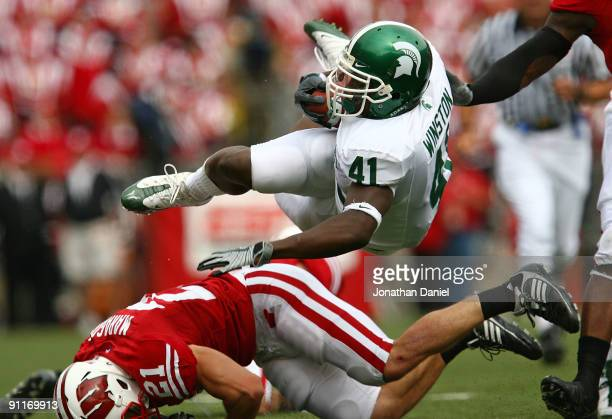 Glenn Winston of the Michigan State Spartans is tripped up by Chris Maragos of the Wisconsin Badgers on September 26, 2009 at Camp Randall Stadium in...