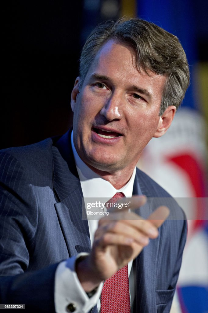 Glenn Youngkin, president and chief operating officer of the Carlyle Group, speaks during a panel discussion at the Infrastructure Week kickoff event at the U.S. Chamber of Commerce in Washington, D.C., U.S., on Monday, May 15, 2017. States and localities that have secured some funding and financing of their own for infrastructure work will be given higher priority access to federal funds under President Trump's forthcoming plan, Transportation Secretary Elaine Chao said during her speech at the event. Photographer: Andrew Harrer/Bloomberg via Getty Images