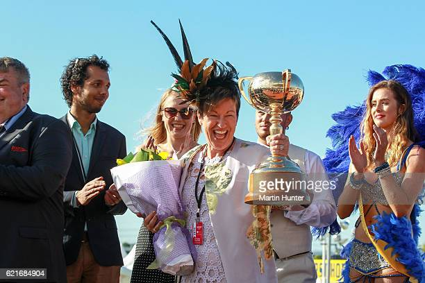 Glenys Kennard part owner celebrates with the NZ Trotting Cup after Lazarus wins Race 10 during New Zealand Trotting Cup Day at Addington Raceway on...