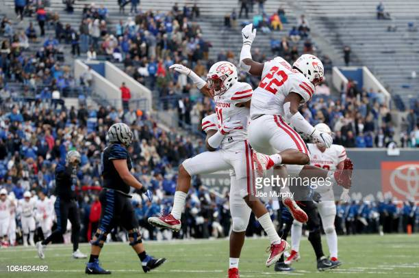 Gleson Sprewell and Austin Robinson of the Houston Cougars celebrate against the Memphis Tigers during the 1st half on November 23, 2018 at Liberty...