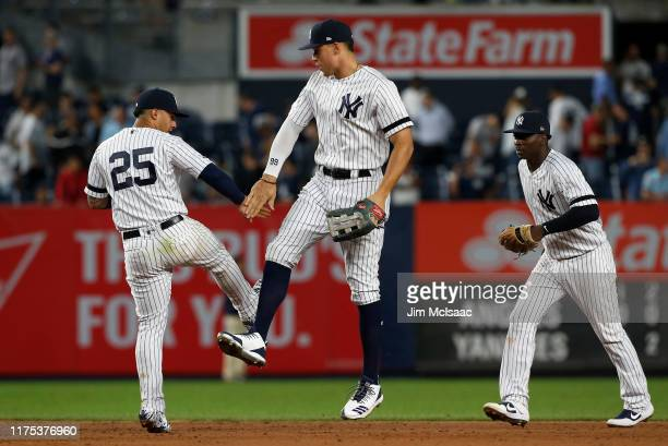 Gleyber Torres, Aaron Judge and Didi Gregorius of the New York Yankees celebrate after defeating the Los Angeles Angels of Anaheim at Yankee Stadium...