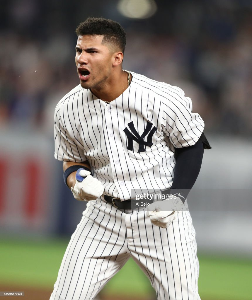 Gleyber Torres #25 of the New York Yankees after hitting a game winning RBI single in the tenth inning against the Houston Astros at Yankee Stadium on May 29, 2018 in New York City.