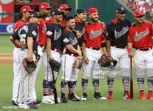 Gleyber Torres of the New York Yankees and the American League and Jose Altuve of the Houston Astros and the American League pose with teammates...