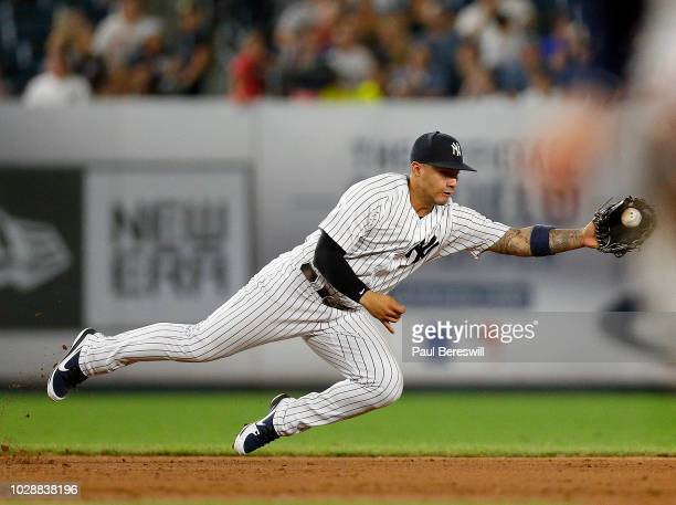 Gleyber Torres of the New York Yankees catches an infield ball hit during an MLB baseball game against the Chicago White Sox on August 27 2018 at...