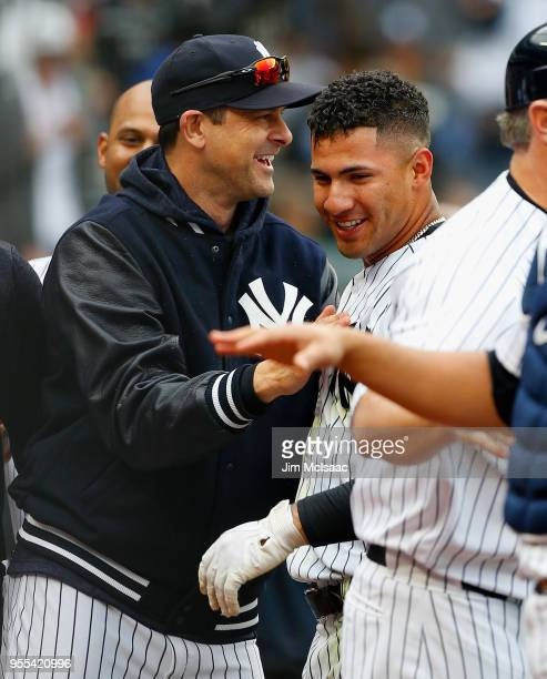 Gleyber Torres of the New York Yankees celebrartes his ninth inning gamewinning threerun home run against the Cleveland Indians with manager Aaron...