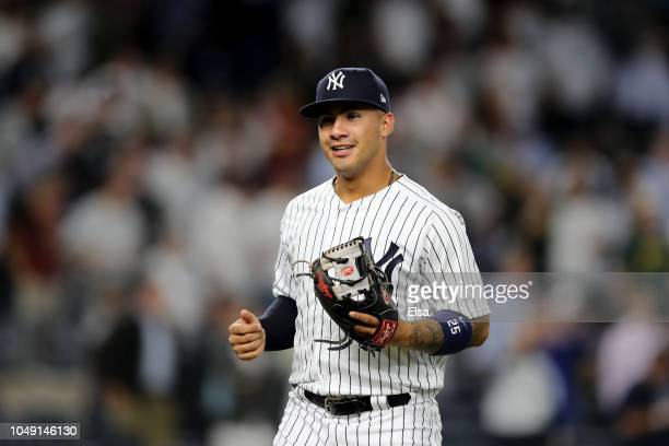 Gleyber Torres of the New York Yankees celebrates after defeating the Oakland Athletics in the American League Wild Card Game at Yankee Stadium on...