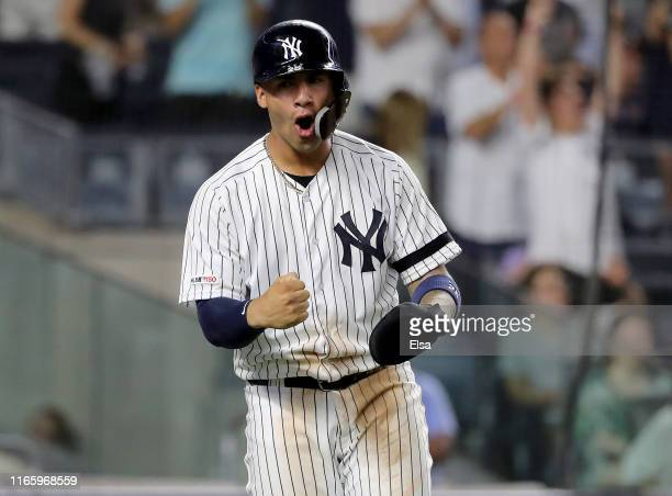 Gleyber Torres of the New York Yankees celebrates after he scored in the seventh inning against the Boston Red Sox during game two of a double header...