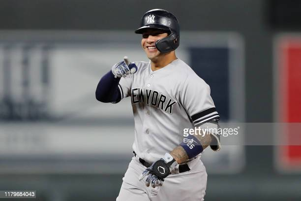Gleyber Torres of the New York Yankees celebrates after his solo home run off Jake Odorizzi of the Minnesota Twins in the second inning in game three...