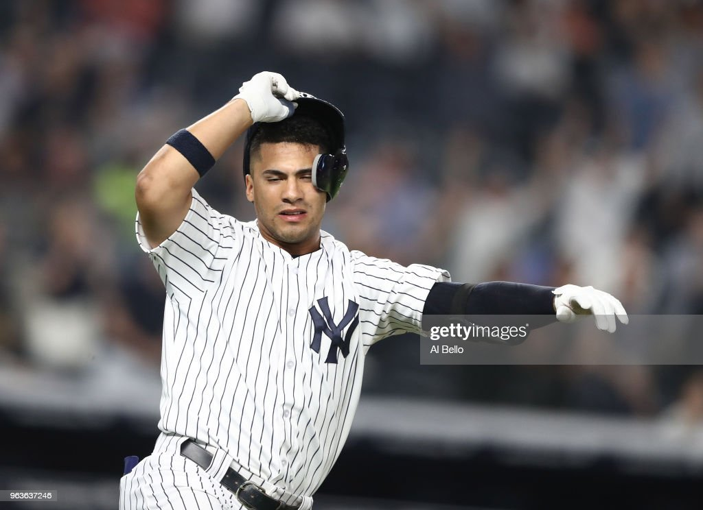 Gleyber Torres #25 of the New York Yankees celebrates after hitting a game winning RBI single in the tenth inning against the Houston Astros at Yankee Stadium on May 29, 2018 in New York City.