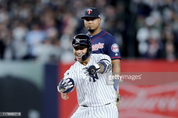 Gleyber Torres of the New York Yankees celebrates after hitting an RBI double to score Aaron Judge and Brett Gardner against Tyler Duffey of the...
