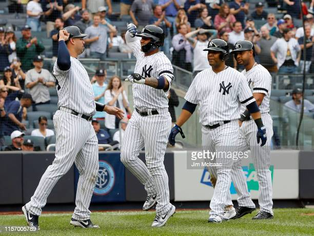 Gleyber Torres of the New York Yankees celebrates his seventh inning grand slam home run against the Tampa Bay Rays with teammates Gary Sanchez Edwin...