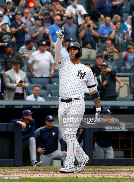 Gleyber Torres of the New York Yankees celebrates his seventh inning grand slam home run against the Tampa Bay Rays at home plate at Yankee Stadium...
