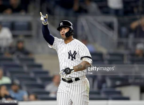 Gleyber Torres of the New York Yankees celebrates his solo home run in the eighth inning against the Cleveland Indians at Yankee Stadium on August 15...