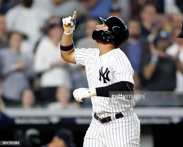 Gleyber Torres of the New York Yankees celebrates his three run home run in the fourth inning against the Cleveland Indians at Yankee Stadium on May...