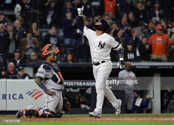 Gleyber Torres of the New York Yankees celebrates hitting a solo home run during the eighth inning against the Houston Astros in game three of the...