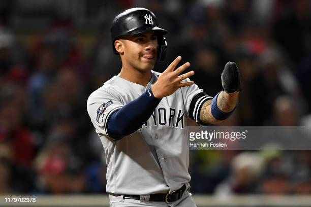 Gleyber Torres of the New York Yankees celebrates scoring against the Minnesota Twins on a single by Didi Gregorius in the seventh inning in game...