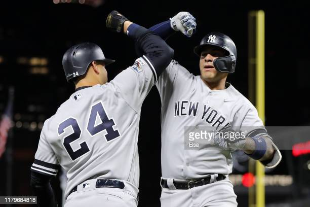 Gleyber Torres of the New York Yankees celebrates with Gary Sanchez after his solo home run off Jake Odorizzi of the Minnesota Twins in the second...