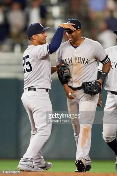 Gleyber Torres of the New York Yankees congratulates teammate Aaron Hicks after the game on July 23 2019 at Target Field in Minneapolis Minnesota The...