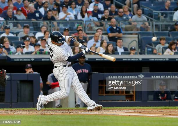 Gleyber Torres of the New York Yankees connects on a first inning grand slam home run against the Boston Red Sox at Yankee Stadium on August 02 2019...