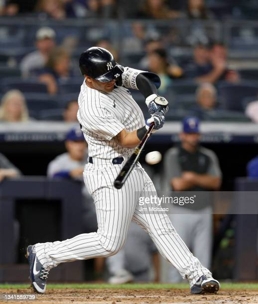 Gleyber Torres of the New York Yankees connects on a third inning RBI base hit against the Texas Rangers at Yankee Stadium on September 20, 2021 in...