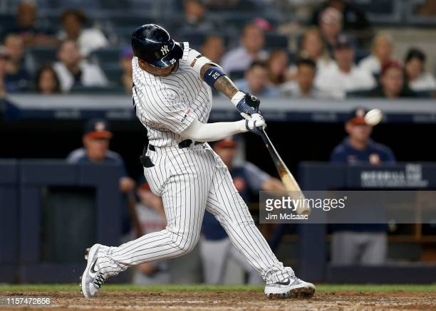 Gleyber Torres of the New York Yankees connects on his seventh inning two run home run against the Houston Astros at Yankee Stadium on June 21 2019...