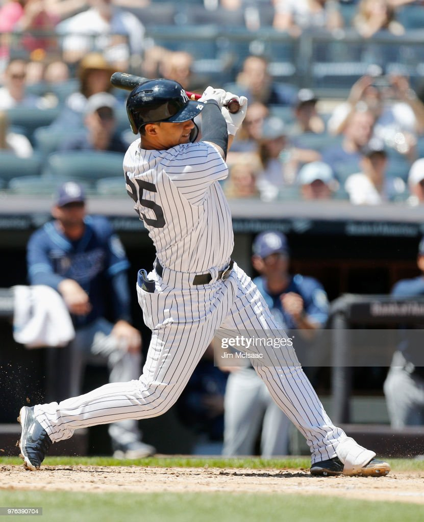 Gleyber Torres #25 of the New York Yankees follows through on a second inning RBI double against the Tampa Bay Rays at Yankee Stadium on June 16, 2018 in the Bronx borough of New York City.