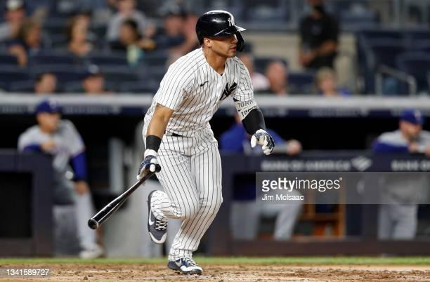 Gleyber Torres of the New York Yankees follows through on a third inning RBI base hit against the Texas Rangers at Yankee Stadium on September 20,...