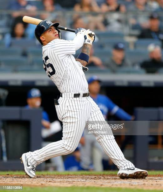 Gleyber Torres of the New York Yankees follows through on his second inning home run against the Toronto Blue Jays at Yankee Stadium on June 25 2019...