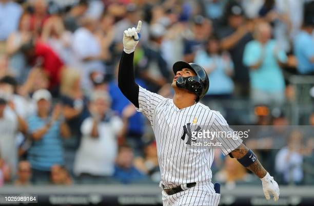 Gleyber Torres of the New York Yankees gestures after he hit a tworun home run during the sixth inning against the Detroit Tigers in a game at Yankee...