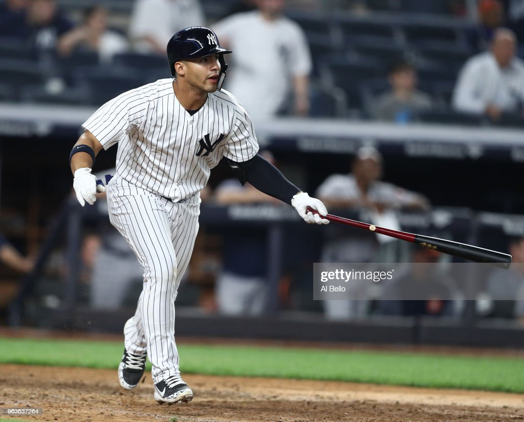 Gleyber Torres #25 of the New York Yankees hits a game winning RBI single in the tenth inning against the Houston Astros at Yankee Stadium on May 29, 2018 in New York City.