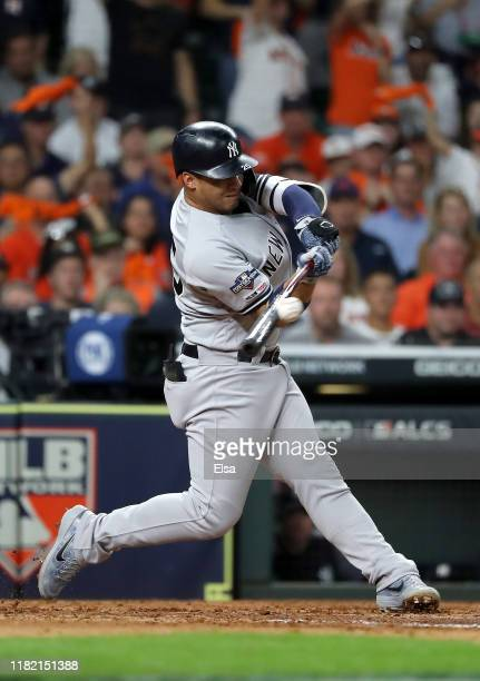 Gleyber Torres of the New York Yankees hits a single against the Houston Astros during the third inning in game six of the American League...