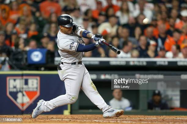 Gleyber Torres of the New York Yankees hits a solo home run against the Houston Astros during the sixth inning in game one of the American League...