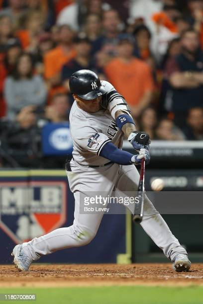 Gleyber Torres of the New York Yankees hits a twoRBI single against the Houston Astros during the seventh inning in game one of the American League...