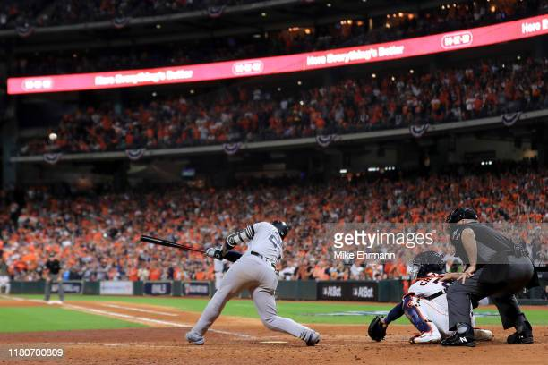 Gleyber Torres of the New York Yankees hits a two-RBI single against the Houston Astros during the seventh inning in game one of the American League...