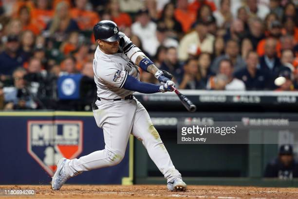Gleyber Torres of the New York Yankees hits an RBI double against the Houston Astros during the fourth inning in game one of the American League...