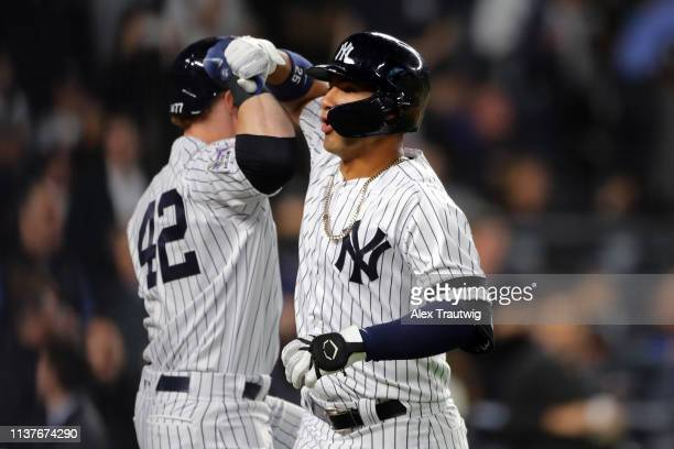 Gleyber Torres of the New York Yankees is greeted by teammate Clint Frazier after hitting a solo home run in the eighth inning during the game...