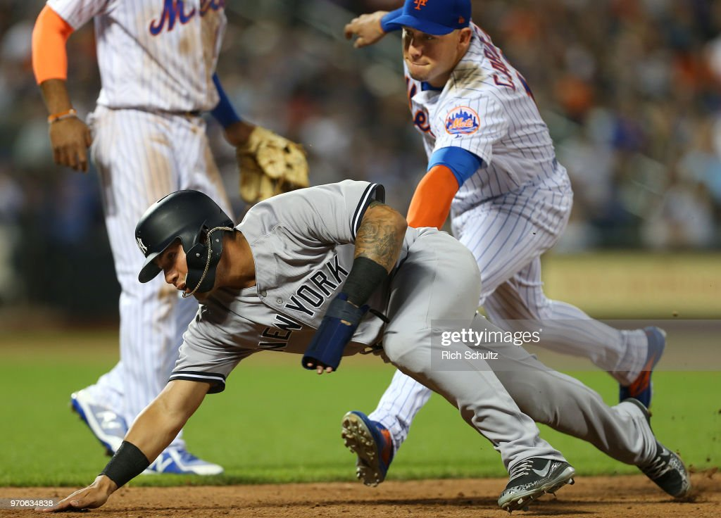 Gleyber Torres #25 of the New York Yankees is tagged out by Asdrubal Cabrera #13 of the New York Mets after being caught in a rundown on a pickoff during the ninth inning of a game at Citi Field on June 9, 2018 in the Flushing neighborhood of the Queens borough of New York City. The Yankees defeated the Mets 4-3.
