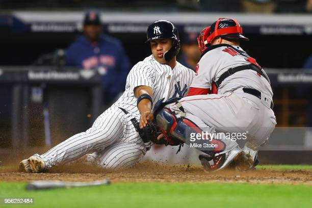 Gleyber Torres of the New York Yankees is tagged out by Christian Vazquez of the Boston Red Sox trying to score on Aaron Judge single in the seventh...