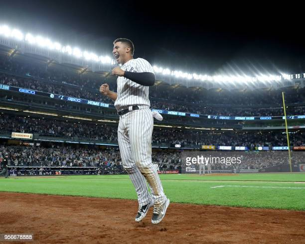 Gleyber Torres of the New York Yankees jumps from the dugout after teamamte Aaron Judge hit a two run home run in the eighth inning against the...