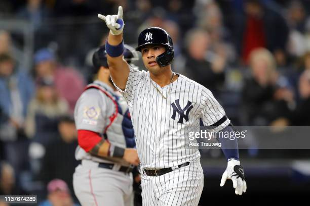 Gleyber Torres of the New York Yankees points to the crowd after hitting a solo home run in the eighth inning during the game between the Boston Red...