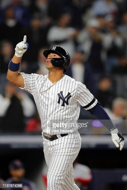 Gleyber Torres of the New York Yankees points to the sky as he crosses home plate after hitting a solo home run in the eighth inning during the game...