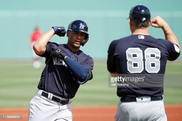 Gleyber Torres of the New York Yankees reacts after hitting a solo home run in the first inning of a Grapefruit League spring training game against...