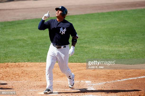 Gleyber Torres of the New York Yankees reacts after hitting a solo home run in the sixth inning against the Detroit Tigers during a spring training...