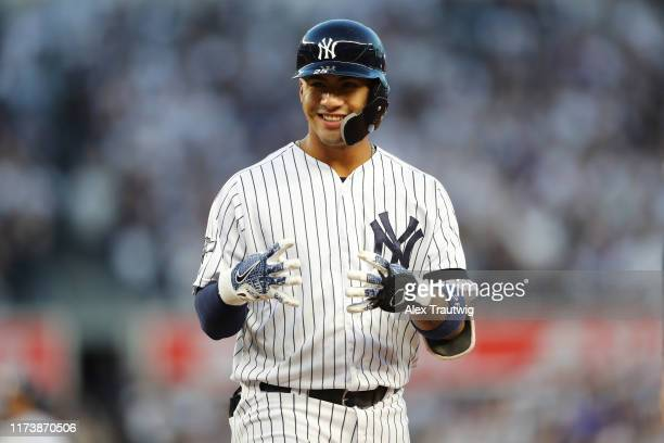 Gleyber Torres of the New York Yankees reacts after hitting an RBI single in the third inning during the ALDS Game 2 between the Minnesota Twins and...