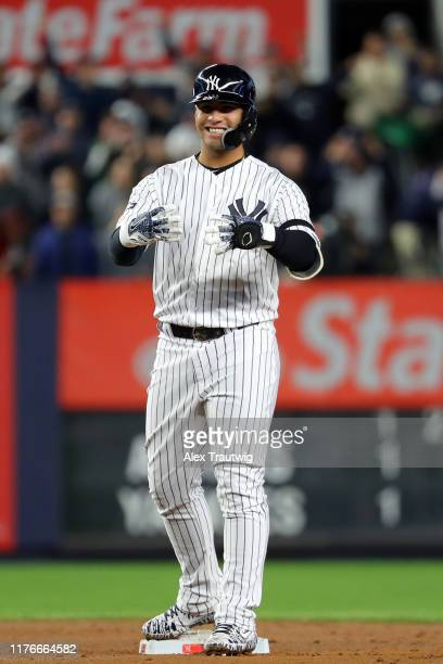 Gleyber Torres of the New York Yankees reacts to hitting a double in the first inning during Game 5 of the ALCS between the Houston Astros and the...