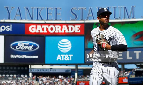 Gleyber Torres of the New York Yankees runs off the field to the dugout after the seventh inning against the Toronto Blue Jays at Yankee Stadium on...